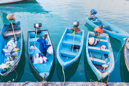 Phuket, Thailand - March, 30, 2019 : Small boats moored in morning time at Chalong port, Main port for travel ship to krabi and phi phi island, Phuket, Thailand Editorial