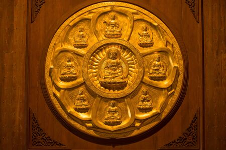 Close-up Groups of gold Buddha statue, stucco on chinese temple wall in Wat Leng Nei Yee 2 Temple, Bangkok, Thailand