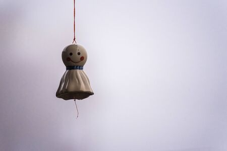 Hanging Doll stop rain made of ceramic white. A symbol of happiness