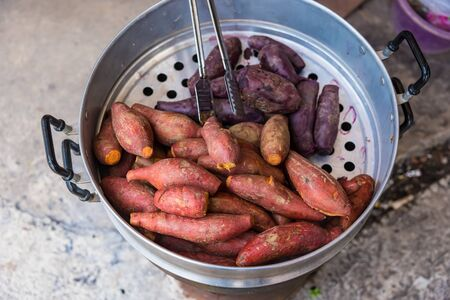 Sweet potatoes baked in a stainless steaming pot Stock Photo