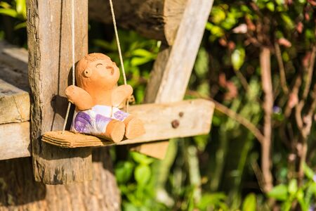 Dolls made from clay in garden.Thailand Stockfoto