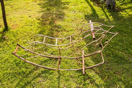 Wrought iron is a rocking horse shape used as a childrens toy in the garden
