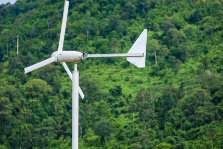 Wind turbine against clean energy, create energy in the forest