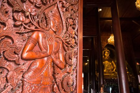 Native Thai style carving, painting on church door in the temple Banco de Imagens