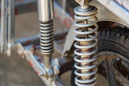 Motorcycle shock absorber spring, Through the use of longer