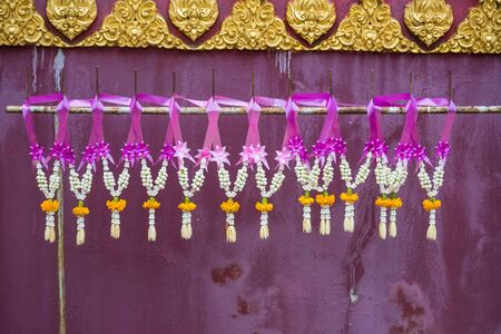 Flower garland hanging in the temple Stockfoto - 129390823