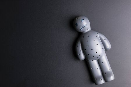 Voodoo Doll on a black background with dramatic lighting Zdjęcie Seryjne