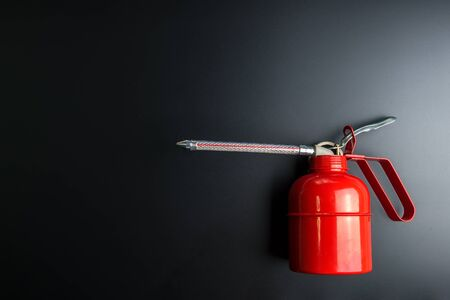 Red spray gun isolated over black background Banco de Imagens