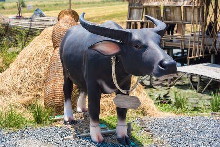 Buffalo statue near the rice field