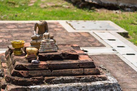 Broken Buddha statue dumped at Wat Mahathat, Ayutthaya, Thailand