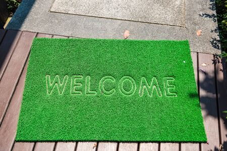 Dust green carpet welcome message Stockfoto