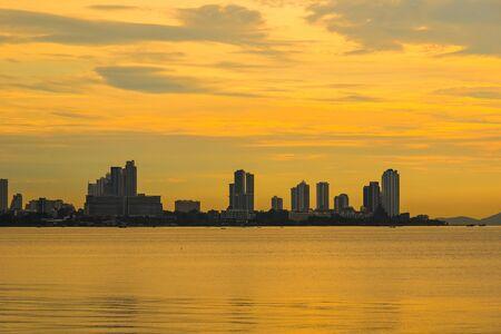 Beautiful sunset and modern city with sea font ,Pattaya,Thailand