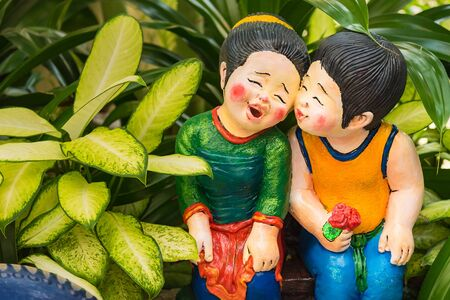 Doll potters in the garden Stok Fotoğraf