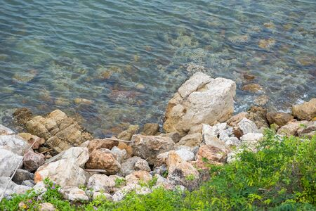 The rocky shore of the sea. Turquoise beautiful water