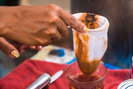 Making traditional Thai milk tea using coffee bag in Stainless Steel Pot. Old Thai tea made shop street food