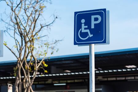 Sign public concept, disabled people parking car sign on pump oil fuel service Stockfoto