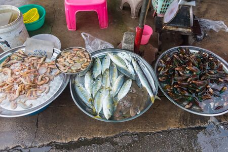 Seafood processing at fish market