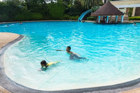 Chon Burii, Thailand - October, 05, 2019 : Swimming pool in the tide hotel at Bang Saen at Chon Burii, Thailand and people are enjoying sunny weather Archivio Fotografico - 134817415