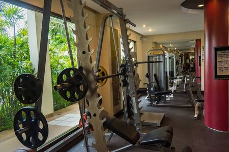 Chon Burii, Thailand - October, 06, 2019  : Fitness room with many type sport equipment in the tide hotel at Chon Burii, Thailand. Gym background Publikacyjne