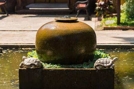 Close up jar fountain in the garden
