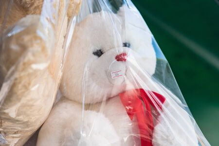 Dolls in plastic bag in shop at thailand