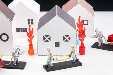 Toys staff are fighting fire, house fires and rescue house models isolated on a white background.