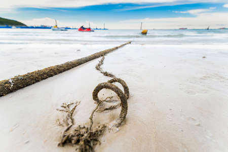 Broken marine rope and sea in background