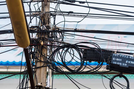 Chon Buri, Thailand - June, 27, 2020 :  Pictures of Messy, messy electrical wires on Tawaen Beach in the day time on Koh Lan island. Редакционное
