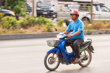 Bangkok, Thailand - December, 25, 2019 : Motion Blurred panning photo of Unidentified name people riding motorcycle on the street at Bangkok, Thailand.