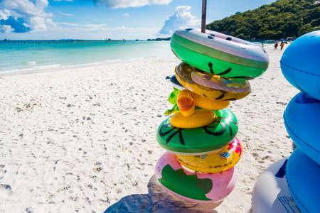Chon Buri, Thailand - June, 27, 2020 : fancy swim tube on the beach Inflatable duck.Fantasy Swim Ring for Summer sea Trip on the Tawaen Beach on Koh Lan island Редакционное