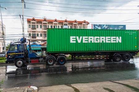 Bangkok, Thailand - June, 23, 2020 :Rainwater spraying from motion big truck car wheels. city road during heavy rain at Bangkok, Thailand.