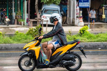Bangkok, Thailand - June, 23, 2020 : Motion Blurred panning photo of Unidentified name man riding motorcycle in the rain on road at Bangkok, Thailand.Road traffic concept