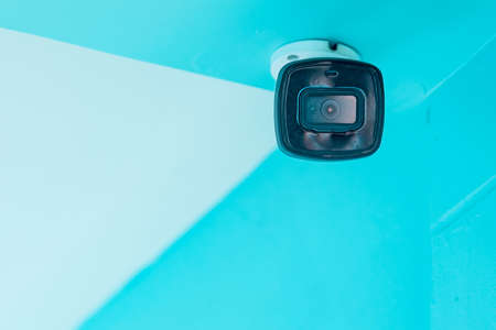Modern CCTV security camera on building wall.Space for text Imagens