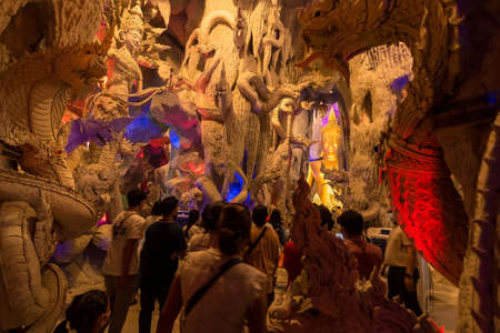 Nakhon Nayok, Thailand - March, 28, 2021 : Naga Cave is enshrines a large Buddha for People worship and wish for good luck at Maniwong Temple at Nakhon Nayok, Thailand.