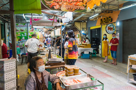 Samut Songkhram, Thailand - April, 04, 2021: Tourists shopping in Amphawa floating market. It is one of the most popular floating markets in Thailand.Many tourists come to travel much less due to the coronavirus outbreak. Editorial