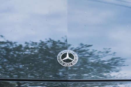 Bangkok, Thailand - April, 04, 2021 : Closeup Mercedes-Benz AMG logo at Mercedes-Benz E350 body at Bangkok, Thailand