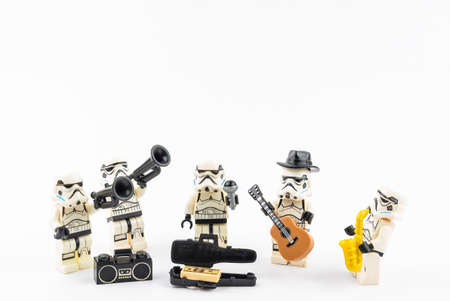 Bangkok, Thailand - April, 26, 2021 : Lego Star Wars plays hat music, accepts street money donations. Street music concept. Editorial
