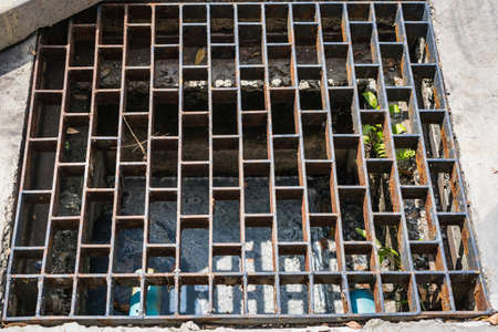 Steel grating of aqueduct for water drainage on the cement floor in thailand.