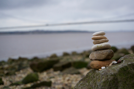 hull: Stacked Stones on a rocky beach by the Humber Bridge, Hull. Stock Photo