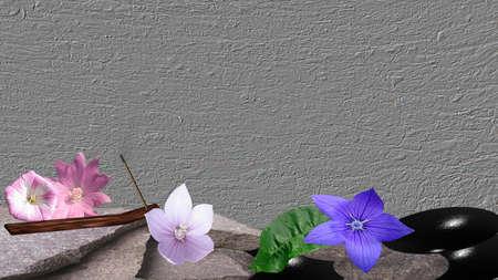 Quarrystones mit Blumen, orange Blatt und Räucherstäbchen auf einem grauen Hintergrund