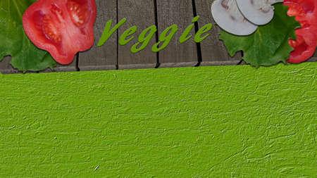 Gemüse auf einem hölzernen Brett und der Text Veggie