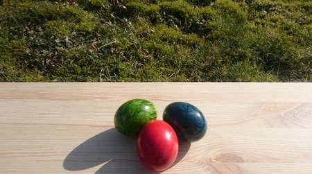 three colorful eggs on wood Standard-Bild