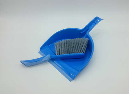 blue dustpan with hand brush