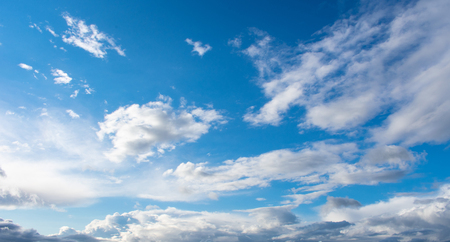 light blue sky with bright clouds
