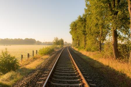 Rural railway line in the early morning Standard-Bild - 109800623