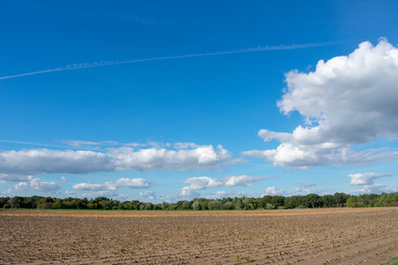 beautiful blue cloud sky over mowed field. Location: Germany, North Rhine - Westphalia, Borken Standard-Bild - 110710661