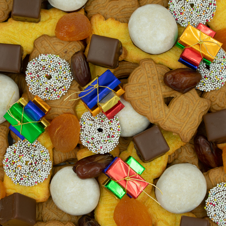 square christmas background from different varieties of christmas cookies and sweets.