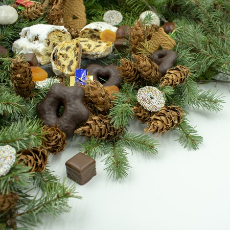 Christmas treats on fir branches.