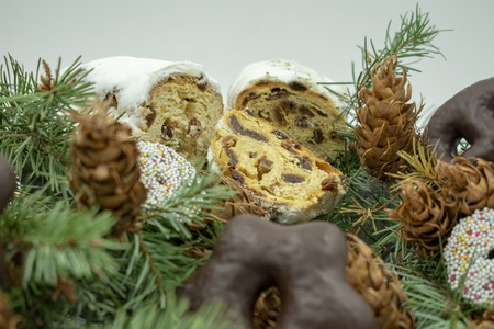 Christmas stollen on fir branches.