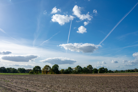 beautiful blue cloud sky with contrails. Location: Germany, North Rhine - Westphalia, Borken Standard-Bild - 110710853